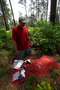 Michael Wilson prepares equipment for banding a brood of 3 red-cockaded woodpecker chicks