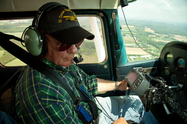 Crop duster and long-time survey pilot Carter Crabbe flying over the Delmarva Peninsula toward the survey's starting location on Assateague Island. Carter has flown the shorebird survey since its initiation in 1994. Photo by Bryan Watts.