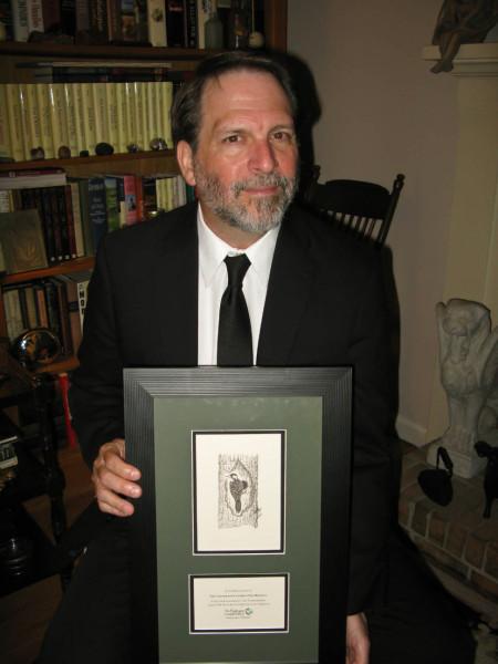 Bryan Watts displays 2014 conservation partner award. Photo by Marian Watts.
