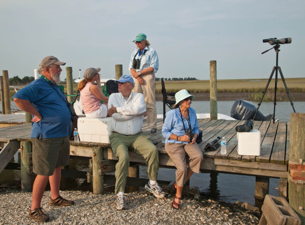 Barry Truitt, Jill Bieri, Jack Burke, Judith Burke, and Tata Kellam wait on Box Tree dock for whimbrels to begin flying. Photo by Bryan Watts.