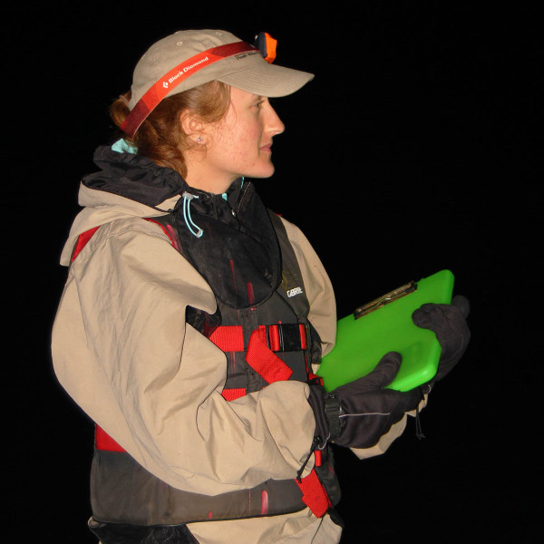 Katie Rittenhouse dons anti-mosquito gear to conduct a nocturnal black rail survey in North Carolina. Photo by Zak Poulton.