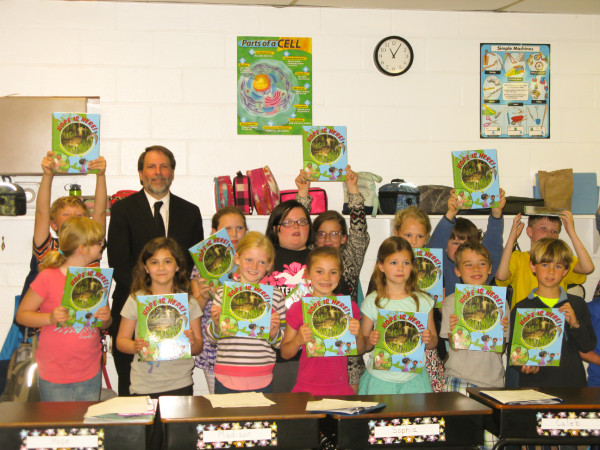 """Bryan Watts with students from Broadwater Academy after they received their own copies of Hope is here."""""""
