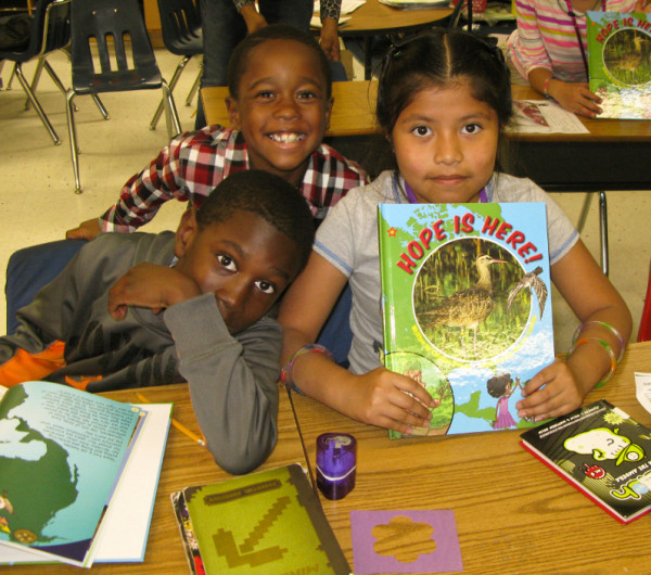 Pungoteague Elementary students display their new book about Hope the whimbrel and her migratory adventures.  Photo by Bryan Watts.