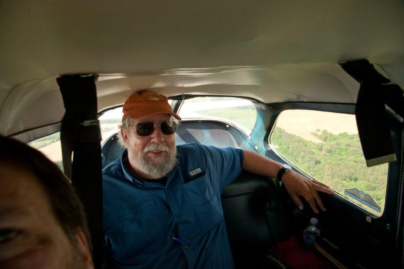 Barry Truitt in the back of survey plane