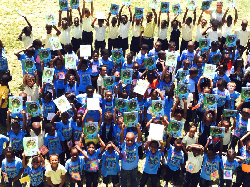 "Children from Cruz Bay hold up their copy of ""Hope is Here.""  Photo courtesy of Cristina Kessler."