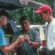 Don Schwab, Rick Barnett  and Brian VanEerden feed a cricket to a woodpecker
